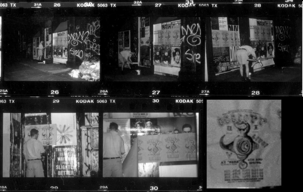 a 1995 photo of Elliott Earls paper pasting posters for his performance series at HERE the independent Art Center